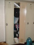 Tall locker stuffed with music, etc.